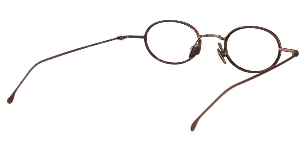 Στρογγυλά μεταλλικά ανδρικά και γυναικεία γυαλιά οράσεως Komono Sinclair Bronze Bourbon σε σκουρόχρωμη ταρταρούγαγια μικρά πρόσωπα.
