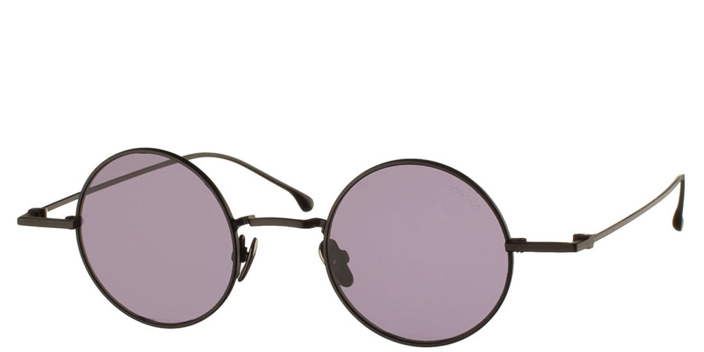 Μεταλλικά στρογγυλά ανδρικά και γυναικεία γυαλιά ηλίου Komono Eli Deep Purple σε μαύρο ματ σκελετό και επίπεδους σκουρόχρωμους μωβ φακούς.