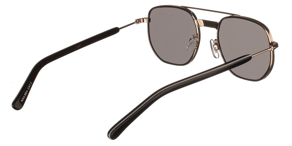 Τετράγωνα μεταλλικά unisex γυαλιά ηλίου Nailsea σε χρυσό και μαύρο σκελετό και επίπεδους γκρι φακούς της εταιρίας Spitfire για όλα τα πρόσωπα.